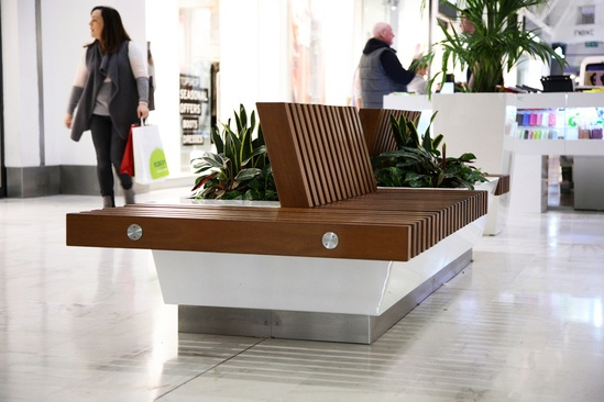 Bespoke iroko timber seat and planter - shopping centre