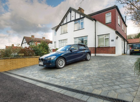 Completed driveway with integrated channel drainage