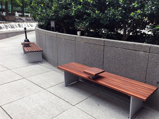 Backless FSC iroko benches with darkened timbers