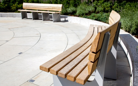 Curved Norfolk benches at Fulham Reach, London