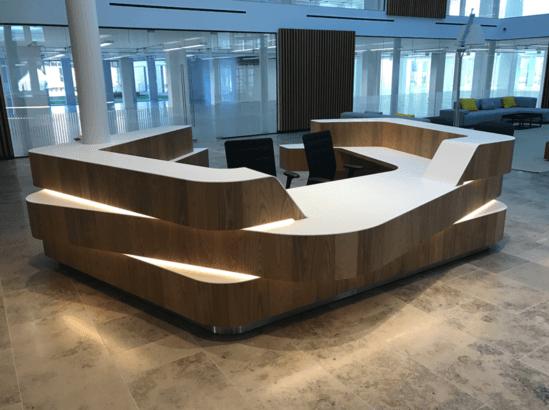 Bespoke reception desk in elm and Coriam