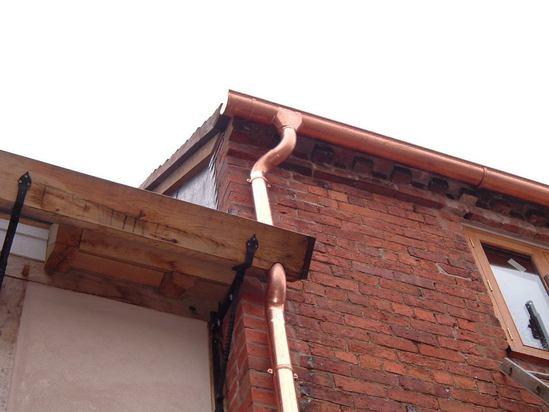 Bespoke copper gutter working alongside timber gutter