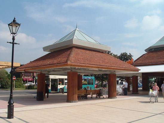 Ogee guttering with round downpipes, supermarket canopy