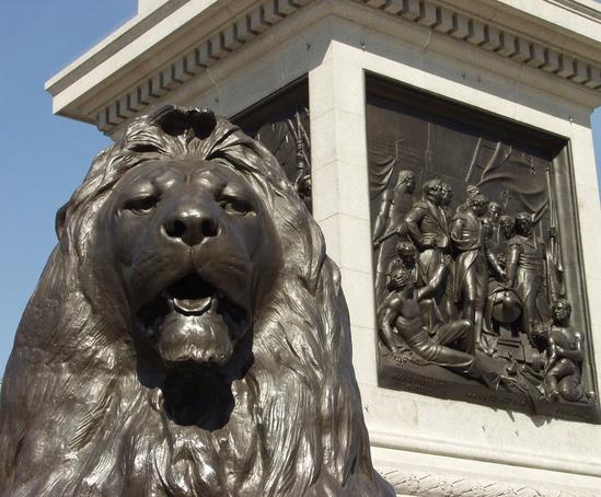Bronze lion sculpture and plaque at Nelson's Column