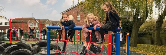 Kids playing on trim trail at Glendale Infants School