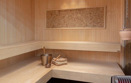 Asia sauna with pale aspen timber and cantilever bench