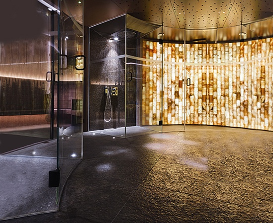 Printed glass wall separating the sauna and steam rooms