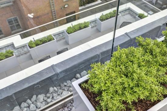 Bespoke steel planters for 2 roof terraces