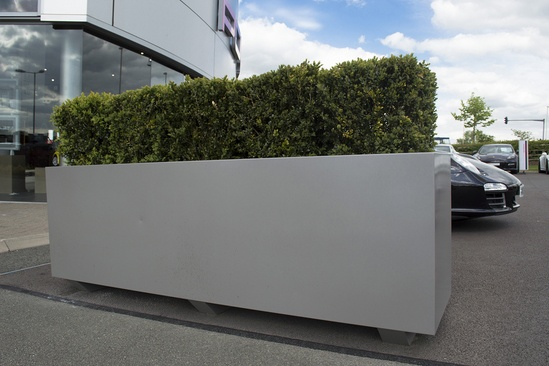 Metal Vehicle Planters : Bespoke movable steel planters for porsche forecourt