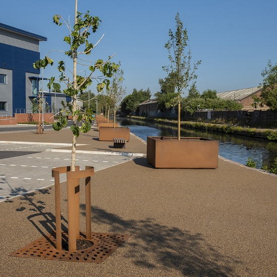 Corten steel tree grilles, guards amd tree planters