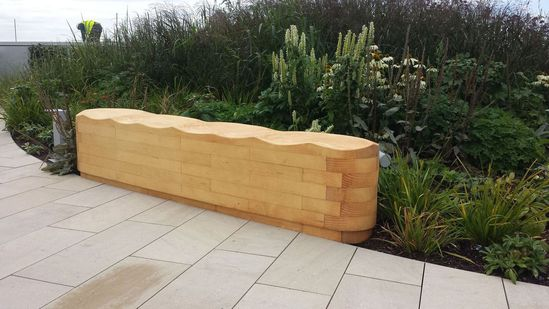 Carved Accoya wood seating