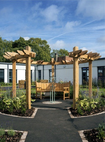 Curved oak pergola and seating