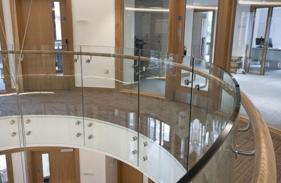 Structural glass balustrades with hardwood handrail