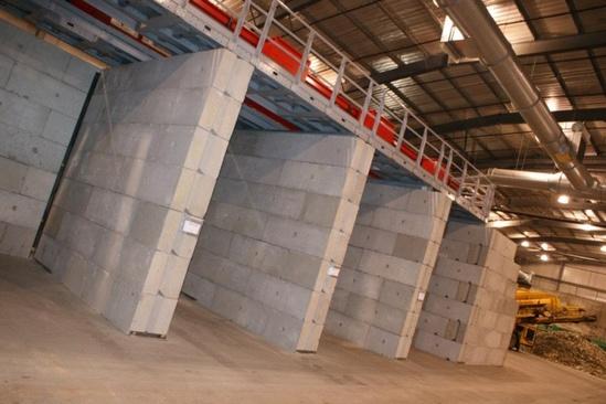 V-interlocking concrete building blocks