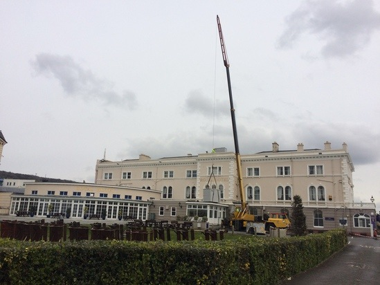 Water storage tank craned to the The Royal Hotel's roof