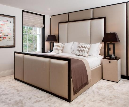 Varley wood framed bed with fabric panel detail