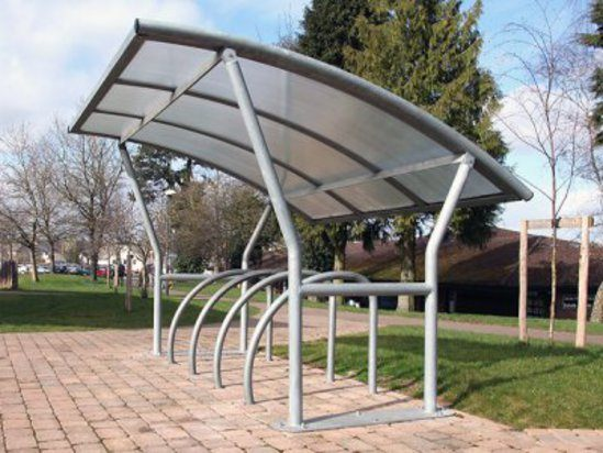 Academy cycle shelter with Fin cycle stands