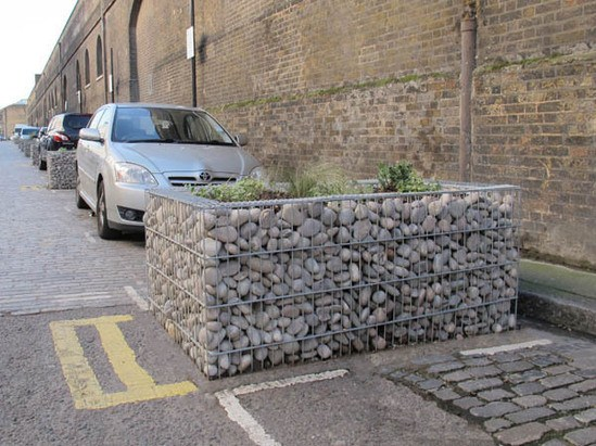 Gabion planters used to create gaps between parking bay