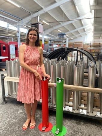 Catherine Barratt with new hand sanitiser dispensers