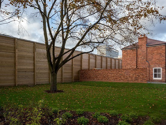 The natural timber has the appearance of garden fencing