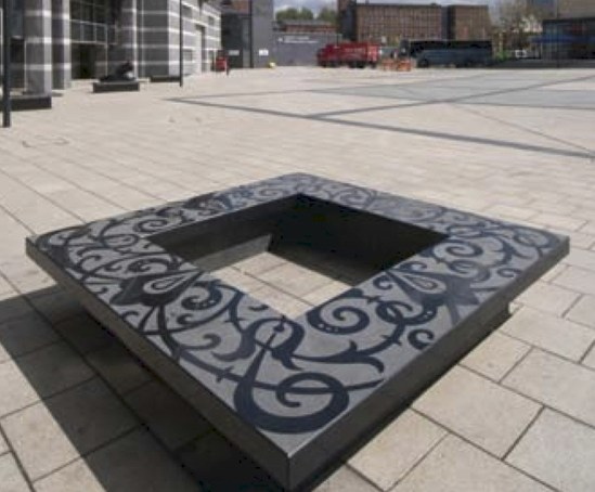 Bespoke black granite bench and Perfecta paving