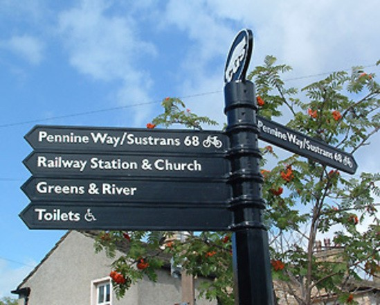 Fingerpost with cast iron finial and decorative collars