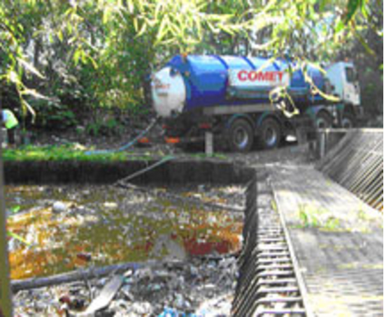 Oil and debris had been discharged into a stream