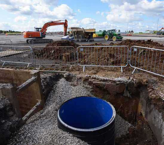 Surface water drainage system for major airport car park for Surface drainage system