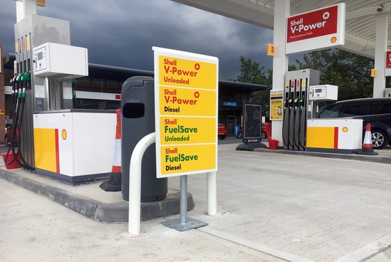 Hoop barrier protects fuel pumps at garage