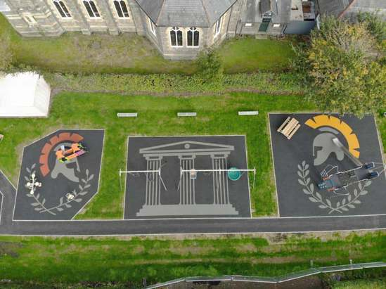 Gladiator themed safety surfacing - Caersws play area