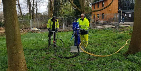 Aeration injector decompacting soil around trees