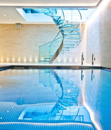 Pool And Wellness Area With Spiral Staircase London Swimming Pool Company Esi Interior Design