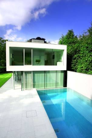 Infinity pool design and build london swimming pool for Swimming pool design and build