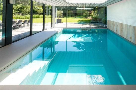 Luxury indoor pool with outdoor views