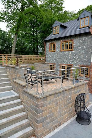 Retaining wall solves slope problem at The Woodlands