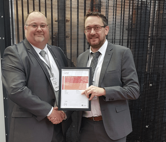 Zaun accepting CorruSec accreditation certificate