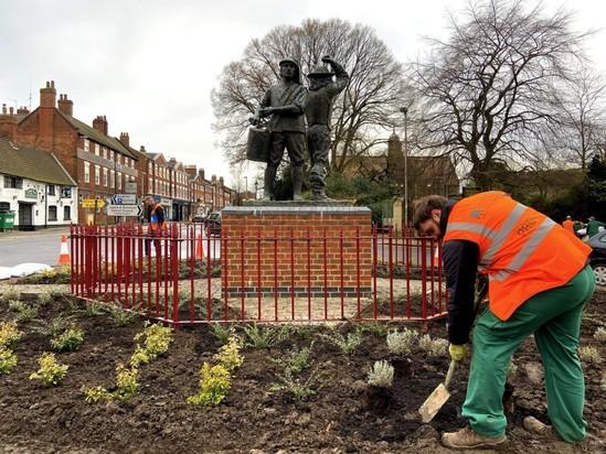 Vertical bar railings now protect the memorial statue