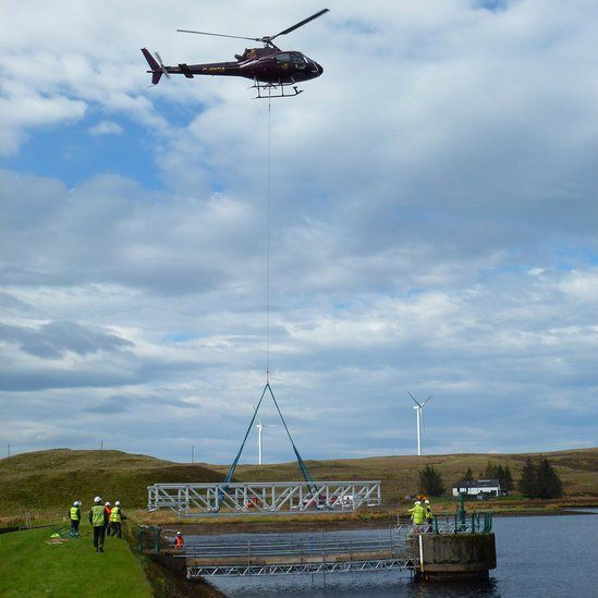 FRP bridge being installed by helicopter