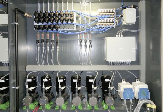 Detergent dosing cabinet with M-Block multi-port valves