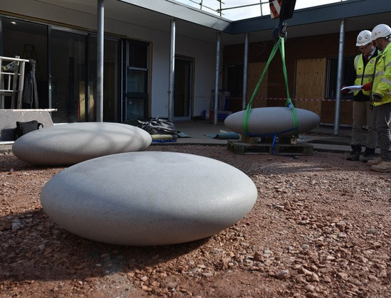Carefully manoeuvring Pebble Seats into position
