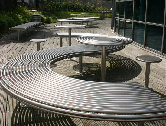 Centerline curved seating, tables and stools
