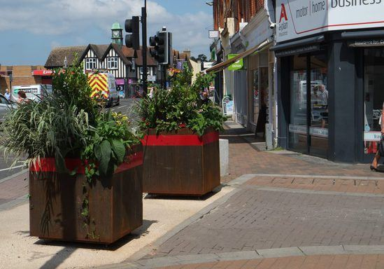 The planters provide a discrete barrier to traffic