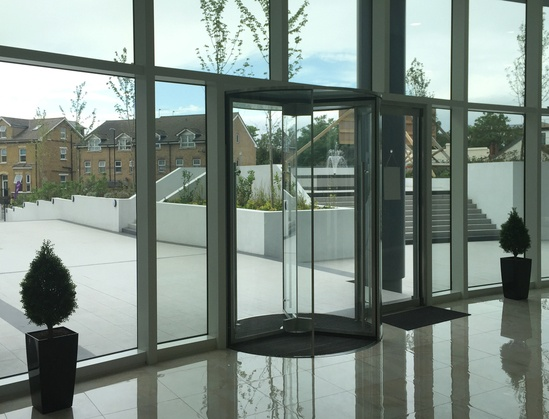 TORMAX revolving door to top residential development