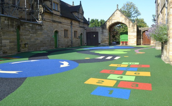 Wet pour rubber surfacing for play area