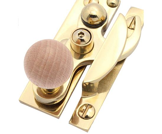 Arbor sash fastener in polished brass with beech knob