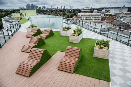 Slatted loungers and planters for rooftop garden