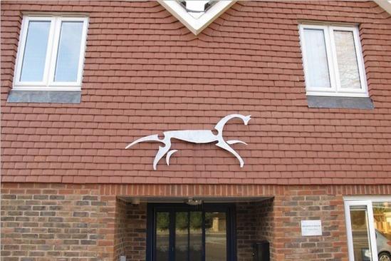 Highfield House horse logo sculpture