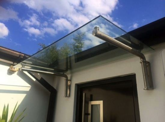 Type m glass door canopy with tubular brackets house of canopies esi building design - The tubular glass house ...