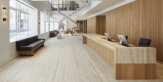 Bespoke marble & timber reception desk; oak panel wall