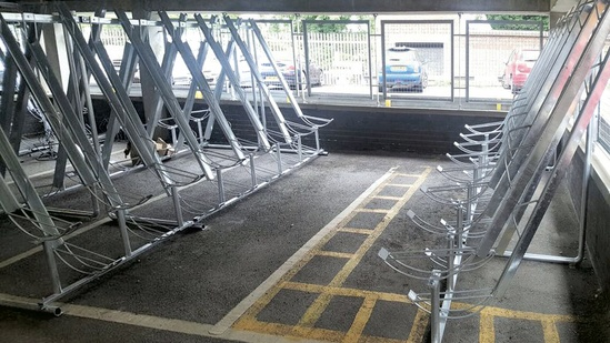 Space-saving semi-vertical cycle racks